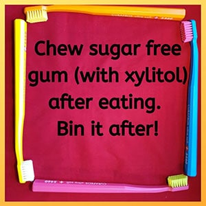 Chew sugar free gum (with xylitol) after eating. Bin it after!