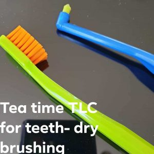 image of toothbrush and a single tufted brush